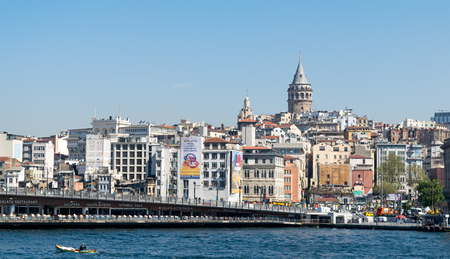 Istanbul, Turkey - April 26, 2017: City view of Istanbul, Turkey overlooking Galata Bridge with traditional fish restaurants and Galata Tower in the background Editorial