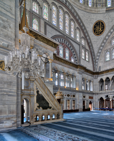 Istanbul, Turkey - April 20, 2017: Interior of Nuruosmaniye Mosque, an Ottoman Baroque style mosque completed in 1755, with a huge arches & many colored stained glass windows located in Fatih district
