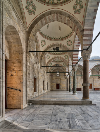 Passage leading to Fatih Mosque, a public Ottoman Baroque style mosque, with columns, arches and marble floor, Fatih district, Istanbul, Turkey Stock Photo