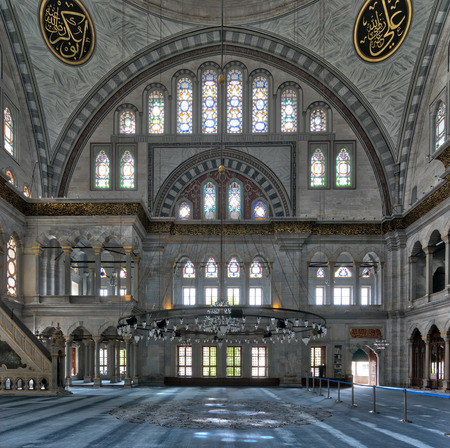 Interior facade of Nuruosmaniye Mosque, an Ottoman Baroque style mosque completed in 1755, with a huge arch & many colored stained glass windows located in Shemberlitash, Fatih, Istanbul, Turkey Stock Photo