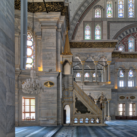 Interior shot of Nuruosmaniye Mosque, an Ottoman Baroque style mosque with minbar (platform), arches & colored stained glass windows located in Shemberlitash, Fatih district, Istanbul, Turkey