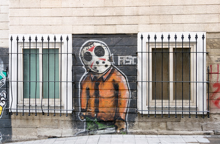 Istanbul, Turkey - April 18, 2017:  Beige bricks external wall with graffiti drawing between two windows near Istiklal Street Editorial