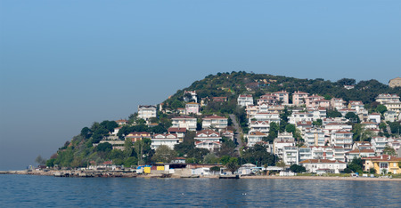 View of Kinaliada island from the sea with summer houses. One of four islands named Princes Islands in the Sea of Marmara near Istanbul, Turkey
