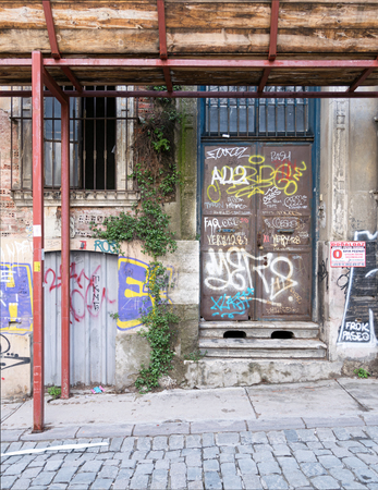 Istanbul, Turkey - April 18, 2017: Grunge abandoned metal door and windoe with random paints