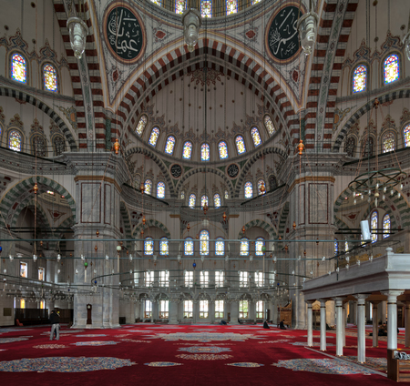Istanbul, Turkey - April 21, 2017: Fatih Mosque, a public Ottoman mosque in the Fatih district, with few people praying and visiting the place
