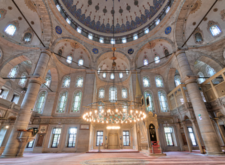 Interior low angle shot of Eyup Sultan Mosque situated in the Eyup district of Istanbul, Turkey, outside the city walls near the Golden Horn. The present building dates from the beginning of the 19th century