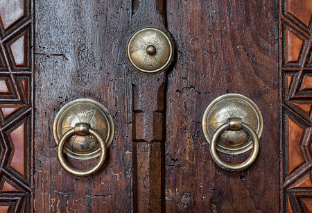 Closeup Of Two Antique Copper Ornate Door Knockers Over An Aged Wooden Door,  Suleymaniye Mosque