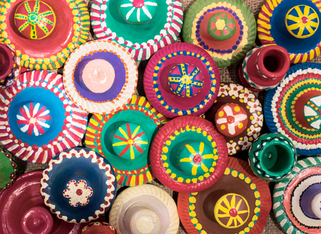 Top view featuring still life composition of handmade artistic painted colorful pottery