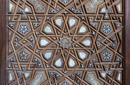 Closeup of arabesque ornaments of an old aged decorated wooden door, Old Cairo, Egypt Stock Photo