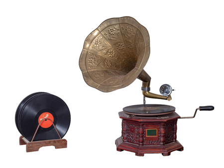 Old nineteenth century phonograph (gramophone) and vinyl records isolated on white including clipping path