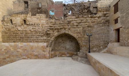 Courtyard of Tekkeyet Al-Bustami with big embedded niche mediating stone bricks wall, Cairo, Egypt