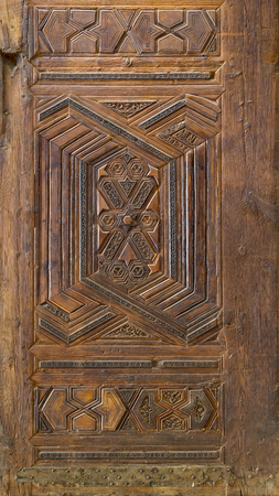 Geometrical and floral engraved patterns of Mamluk style wooden ornate door of Madrasa of Sultan Nagm al Din Ayyub, Cairo, Egypt