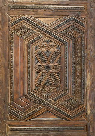 Geometrical and floral engraved patterns of Mamluk style wooden ornate door leaf of Madrasa of Sultan Nagm al Din Ayyub, Cairo, Egypt