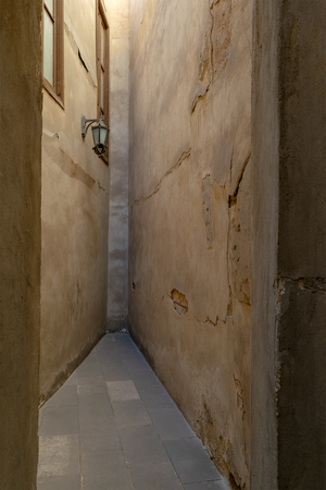 Dead end Narrowing isle with stone grunge walls and lantern, Cairo, Egypt Stock Photo