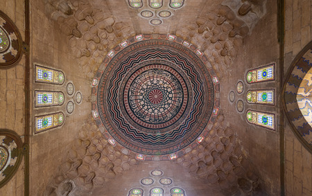 Ceiling of Al Zaher Barquq mausoleum with colorful decorated painted dome, City of the Dead district, Cairo, Egypt