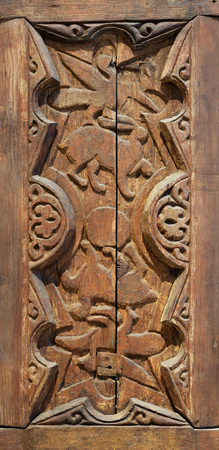 Fatimid era style engraved wooden panel decorated with animal based decorations inside geometric and floral patterns, Cairo, Egypt Stock Photo