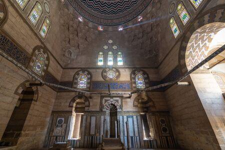 Cairo, Egypt - April 7 2018: Mausoleum of Sultan Al Zaher Barquq and sons at the complex of Al Nasr Farag Ibn Barquq complex located at the city of the dead Editorial