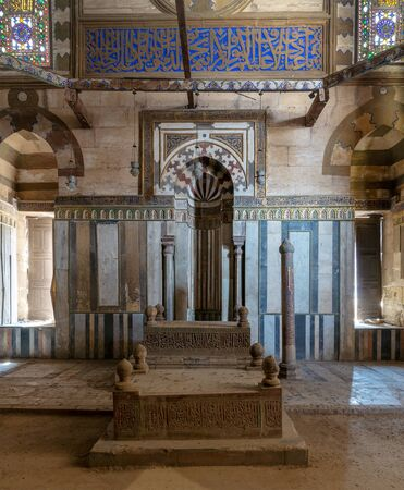 Cairo, Egypt - April 7 2018: Mausoleum of Sultan Al Zaher Barquq and sons at the complex of Al Nasr Farag Ibn Barquq complex, City of the dead, with marble ornate mihrab (niche) and ornate marble wall