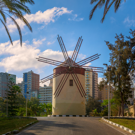 Old traditional windmill at Montaza public park in sunny summer day, Alexandria, Egypt