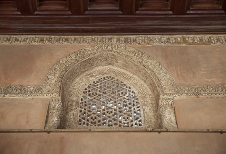 Perforated arched stucco window decorated with geometrical patterns and calligraphy at Ibn Tulun mosque, Old Cairo, Egypt Stock Photo