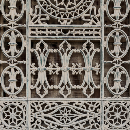 Grunge old window decorated with iron floral patterns, Mosque of Muhammad Ali, Cairo Citadel, Egypt Stock Photo - 105404843