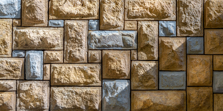 Background of pattern of beige and gray decorative uneven stone wall surface Stock Photo - 105519517