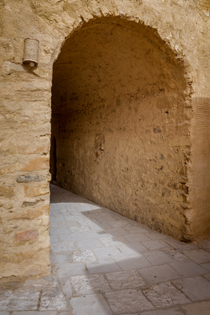 Stone brick wall with aged vaulted passage, Egypt