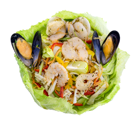 Healthy shrimps salad with green mix and lemon wrapped in lettuce. Top view isolated on white background with clipping path Stock Photo - 105108794