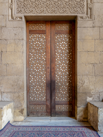 External old arabesque decorated wooden door leading to al Rifai Mosque, Old Cairo, Egypt