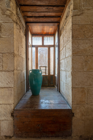 Recessed interleaved wooden window (Mashrabiya) and turquoise vase, Medieval Cairo, Egypt Editorial