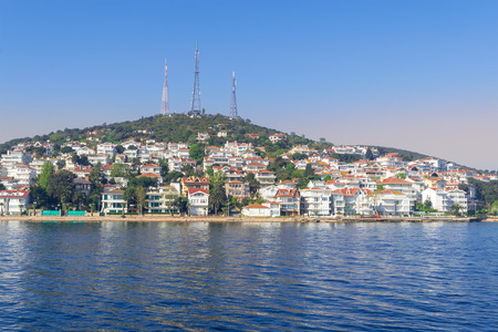 View of Kinaliada island from the sea with summer houses. One of four islands named Princes Islands in the Sea of Marmara near Istanbul Stock Photo - 107240374