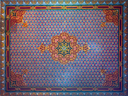 Colorful wooden ornate ceiling with floral and geometrical patterns at historic Manial Palace of Prince Mohammed Ali Tewfik, Cairo, Egypt
