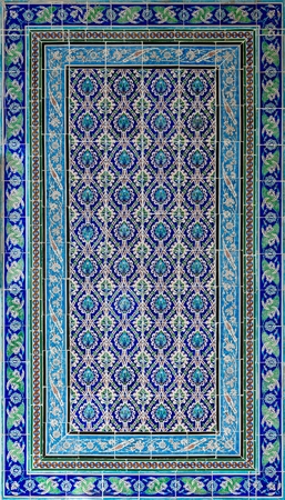 Ottoman style glazed ceramic tiles decorated with floral ornamentations manufactured in Iznik, Turkey located at Historic Manial Palace of Prince Mohammed Ali, Cairo, Egypt Stock Photo - 108922990