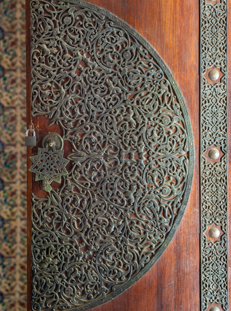 Wooden decorated copper plated door from the royal era, Cairo, Egypt Stock Photo - 108923049