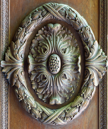 Floral engraved decorations of a royal era wooden ornate door leaf, Manial Palace of Prince Mohammed Ali, Cairo, Egypt Stock Photo - 108923085