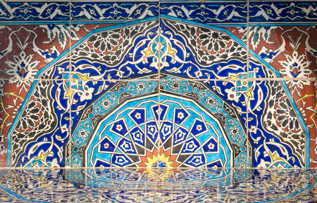 Part of fireplace from the royal era built of Turkish glazed ceramic tiles with floral ornamentations manufactured in Iznik, located at Historic Manial Palace of Prince Mohammed Ali, Cairo, Egypt Stock Photo - 108923086