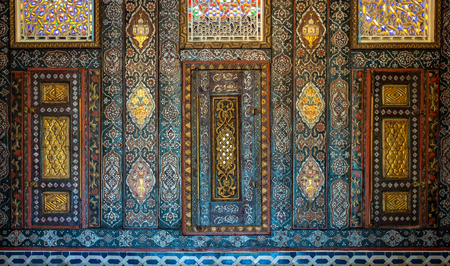 Floral ornaments of wooden embedded cupboards painted with colored geometrical patterns, Syrian hall of historic Manial palace of Prince Mohammed Ali, Cairo, Egypt Editorial