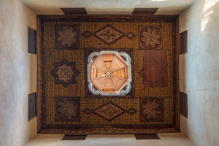 Ottoman era decorated wooden ceiling with floral pattern decorations and wooden dome at historic House of Egyptian Architecture, located in Darb El Labbana district, Cairo, Egypt Editorial