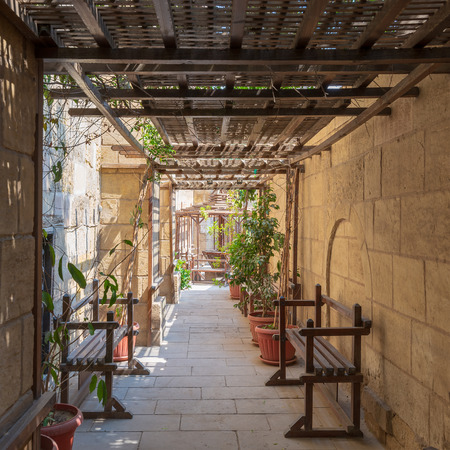 Passage ceiled with wooden pergola leading to the House of Egyptian Architecture historical building from the Mamluk era, Cairo, Egypt Stock Photo - 108923712