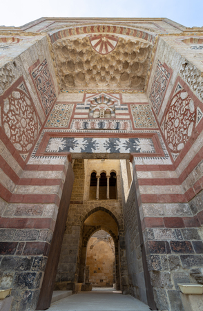 Exterior view of entrance of Al-Muayyad Bimaristan historic building, Darb Al Labana district, Old Cairo, Egypt