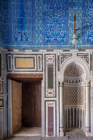Marble wall with mihrab (Embedded niche) at the Tomb of Ibrahim Agha Mustahfizan, Mosque of Aqsunqur (Blue Mosque), Bab El Wazir district, Old Cairo, Egypt Stock Photo - 133071408