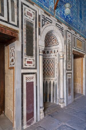 Marble wall with mihrab (Embedded niche) at the Tomb of Ibrahim Agha Mustahfizan, Mosque of Aqsunqur (Blue Mosque), Bab El Wazir district, Old Cairo, Egypt Stock Photo - 133071409