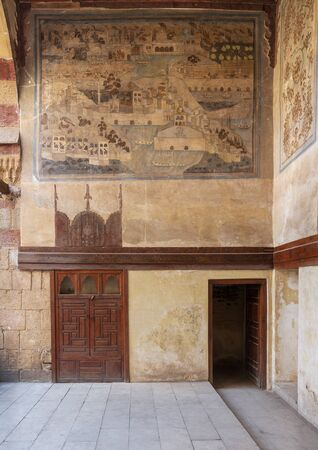 Stone wall decorated with mural depicting Istanbul city at ottoman historic Beit El Set Waseela building (Waseela Hanem House), Old Cairo, Egypt Stock Photo - 133071563