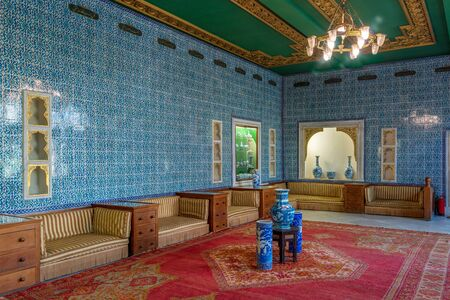 Manial Palace of Prince Mohammed Ali. Blue tiled hall at the residence of the prince's mother with Turkish floral blue pattern ceramic tiles and niches with porcelain vases, Cairo, Egypt Stock Photo - 133071827