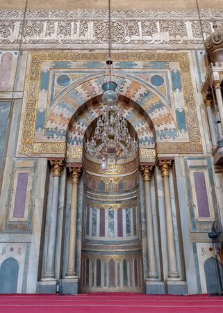 Colorful decorated marble wall with engraved Mihrab (niche) at the Mosque and Madrassa (School) of Sultan Hassan, Cairo, Egypt Stock Photo - 133071964