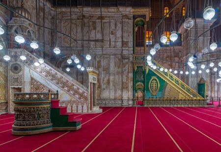 Engraved marble alabaster platform (Minbar) and wooden green decorated platform at the great Mosque of Muhammad Ali Pasha (Alabaster Mosque), situated in the Citadel of Cairo in Egypt Stock Photo - 133071967