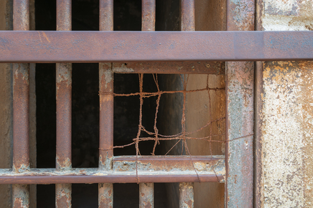 Closeup of a closed rusted iron bars of cell door in closed abandoned prison at Cairo Citadel, Egypt Stock Photo - 127441235