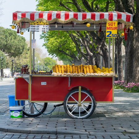 Traditional Turkish chestnut and corn cart in Sultan Ahmed Square, Istanbul, Turkey Stock Photo - 127479286