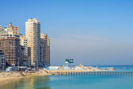 Alexandria, Egypt- April 29 2018: Mediterranean coast at Miami district, Alexandria city, with very tall buildings by the seaside at a sunny summer day Stock Photo - 133072383