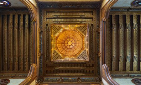 Wooden decorated dome mediating ornate wooden ceiling with floral pattern decorations at Sultan al Ghuri Mausoleum, Cairo, Egypt Stock Photo - 133072384